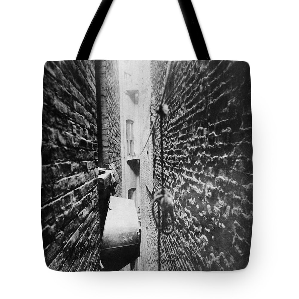 1890 Tote Bag featuring the photograph New York: Tenement, C1890 by Granger