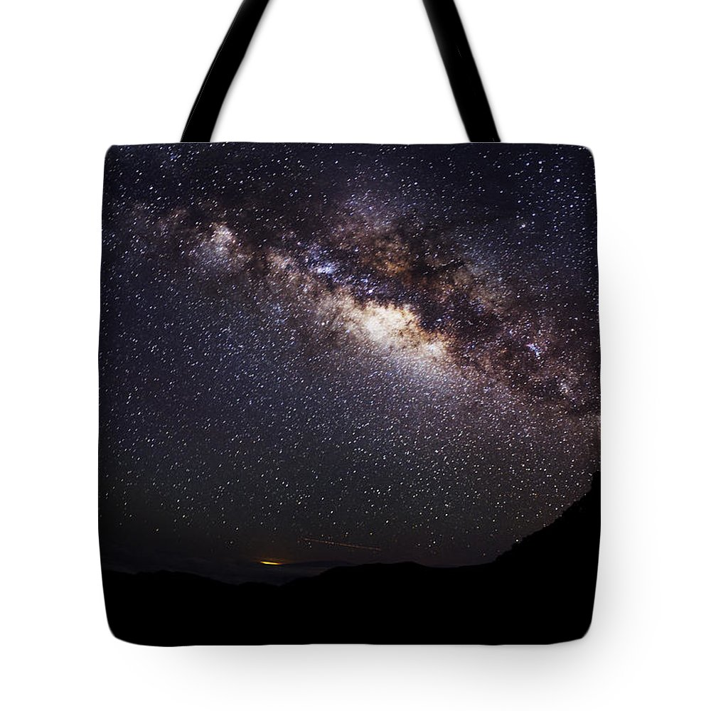 Amazing Tote Bag featuring the photograph Night Sky - Haleakala Summit by MakenaStockMedia - Printscapes