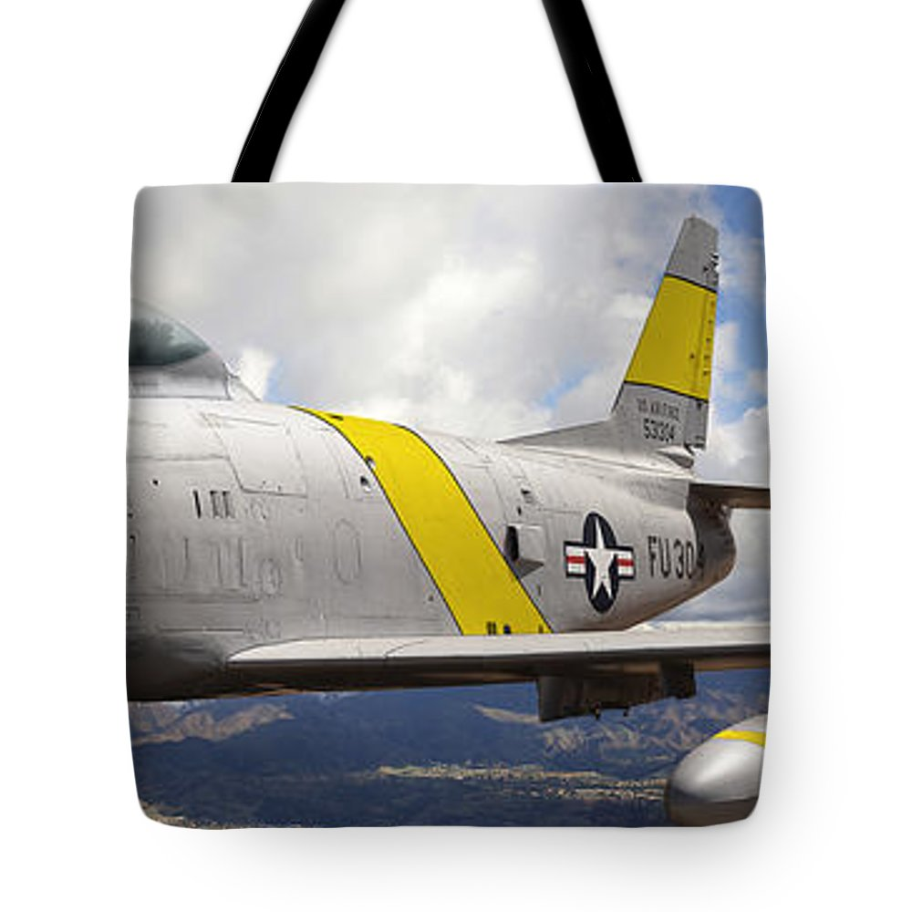 F-86 Sabre Tote Bag featuring the photograph North American F-86 Sabre by Larry McManus