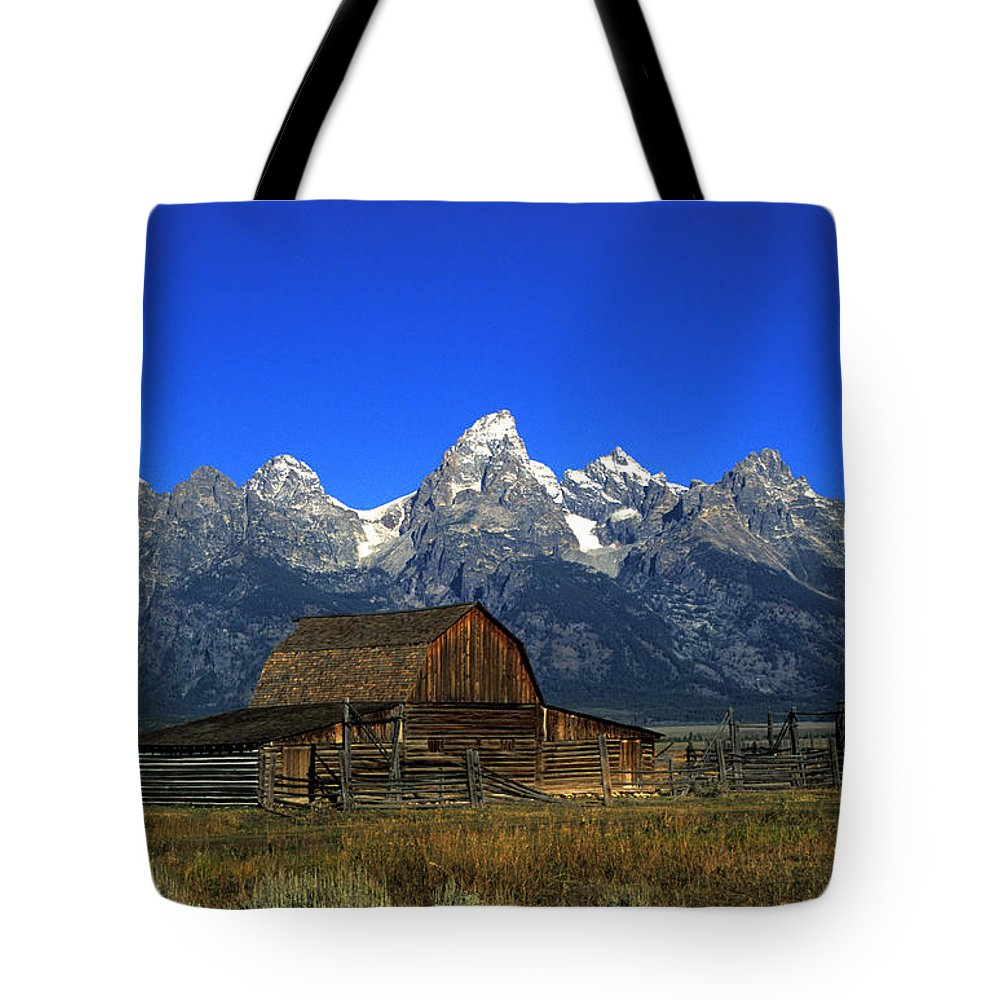 Late Snow Tote Bag featuring the photograph North Moulton Barn Grand Tetons by Gary Langley