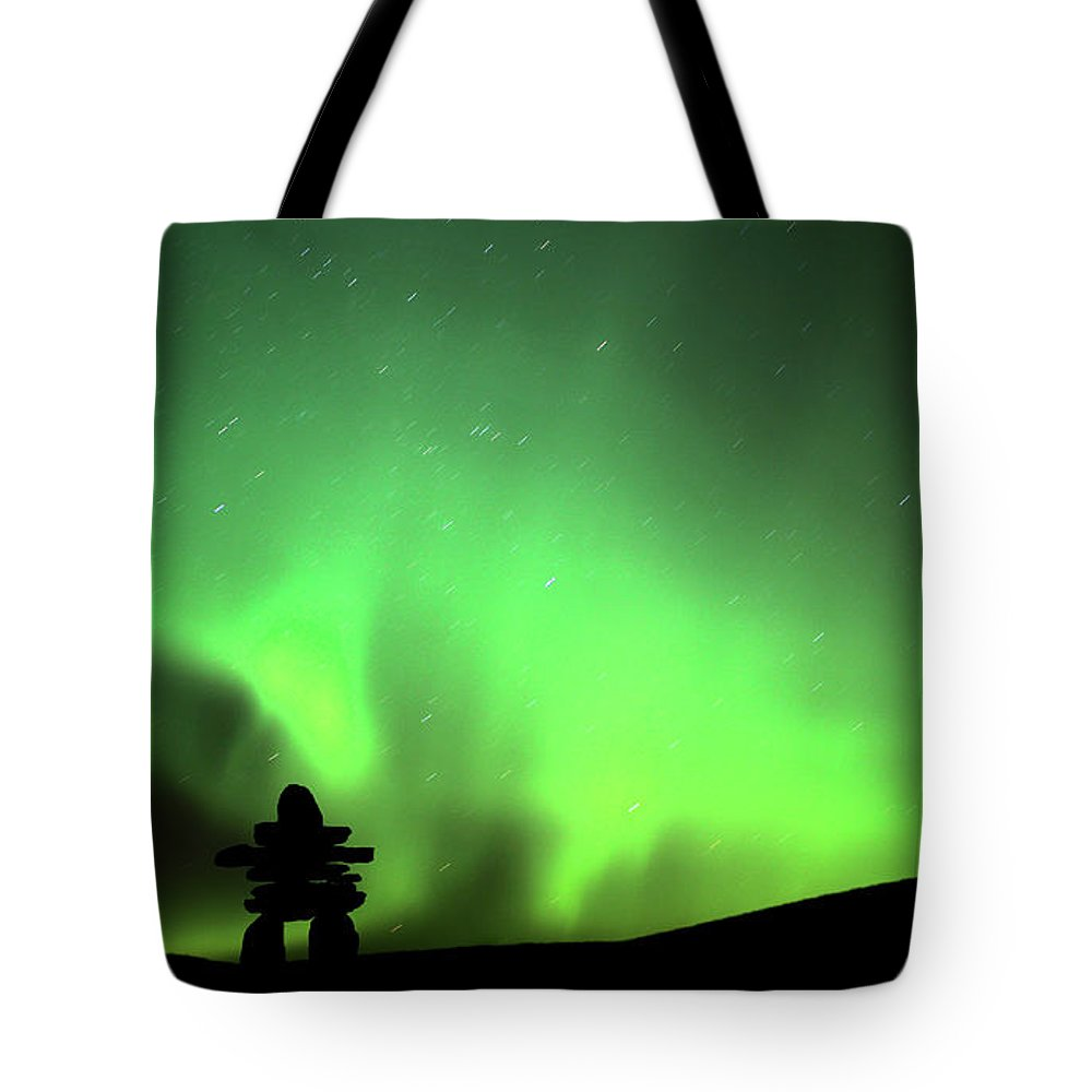 Inukchuk Tote Bag featuring the digital art Northern Light Above An Inukchuk In Saskatchewan by Mark Duffy