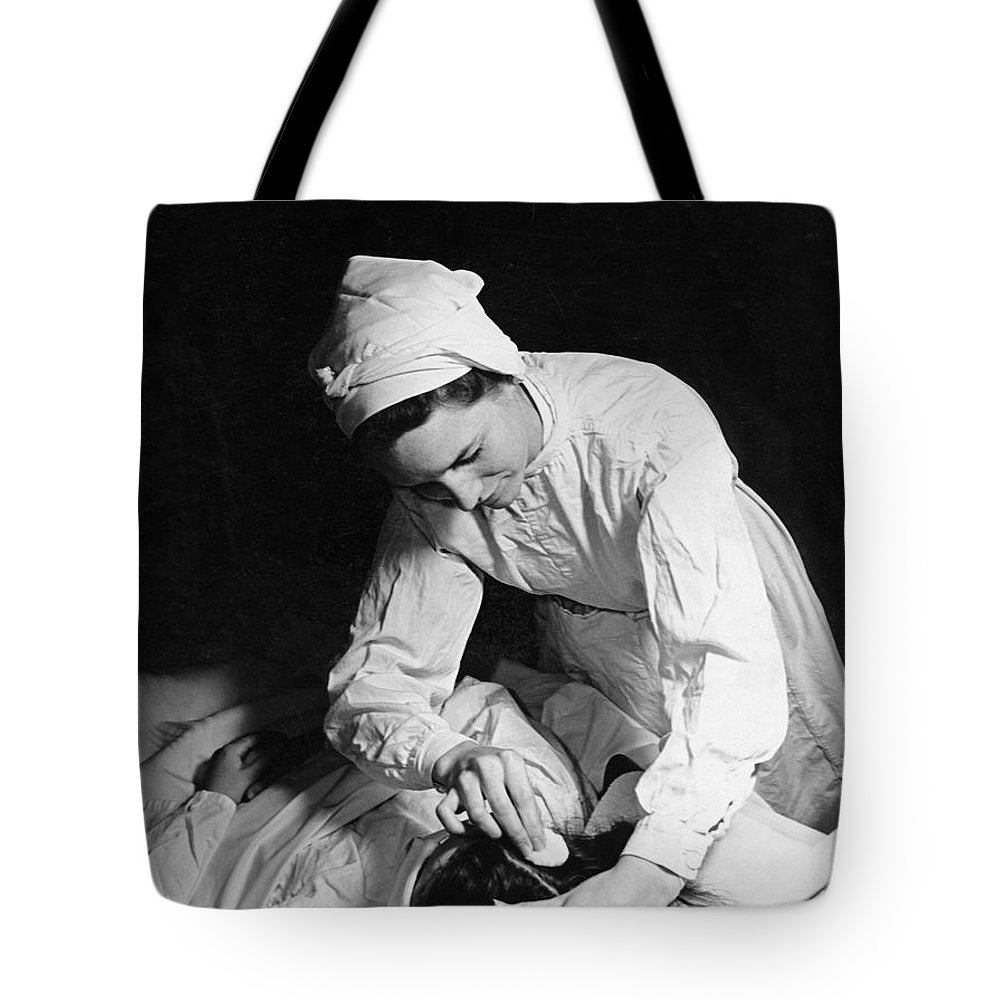 1930s Tote Bag featuring the photograph Nurse Tending To A Patient by Underwood Archives