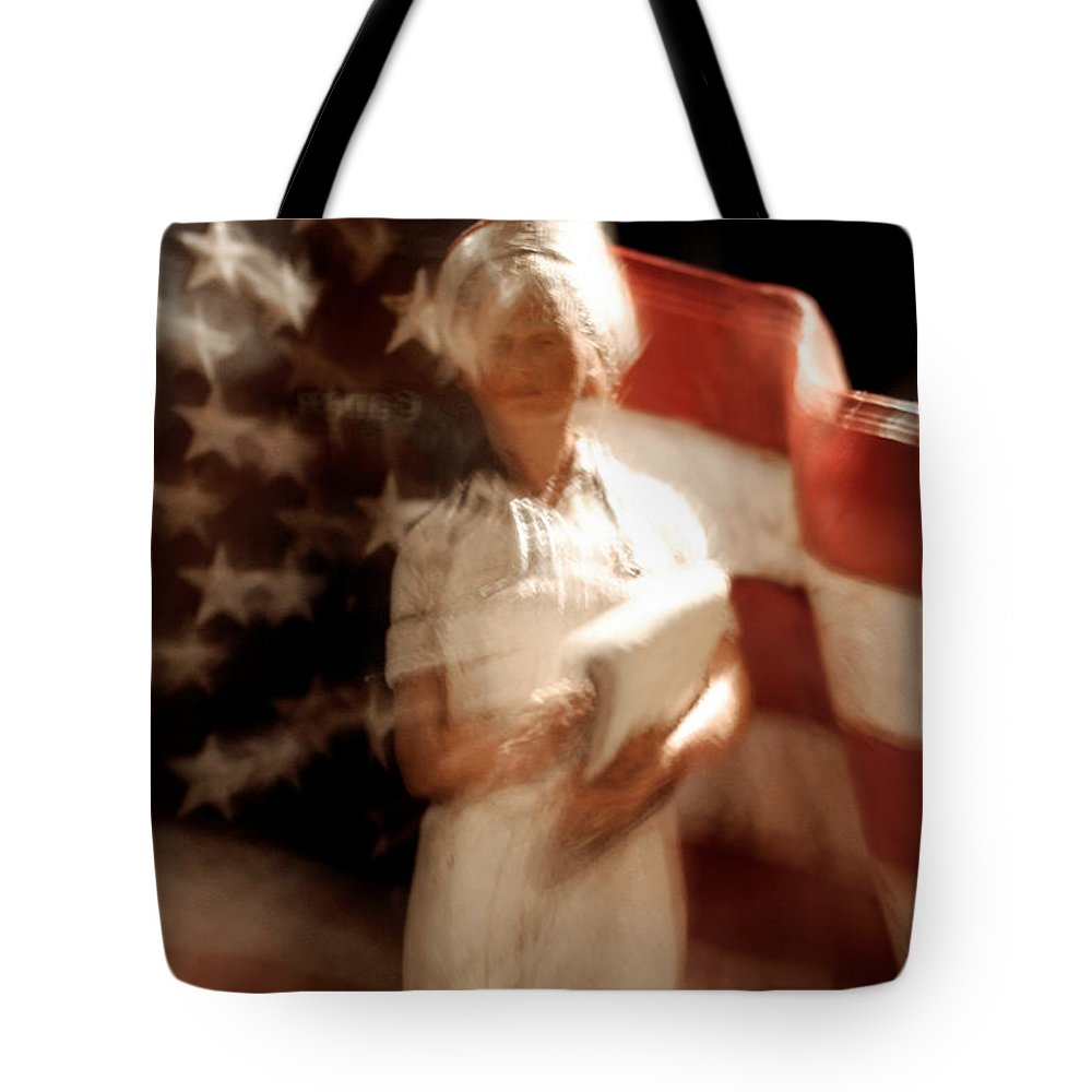 Motion Tote Bag featuring the photograph Nursing America by Ric Bascobert