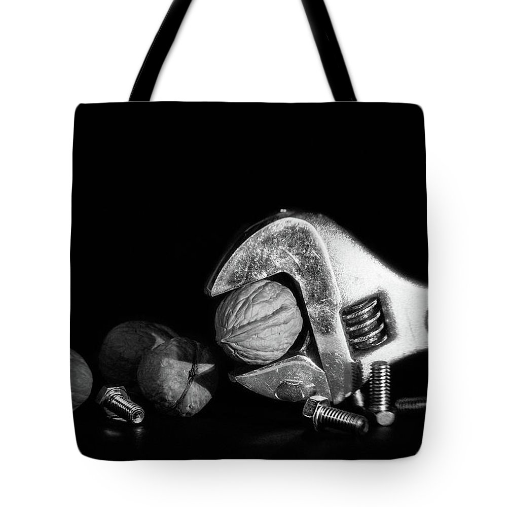 Bolt Tote Bag featuring the photograph Nuts And Bolts by Tom Mc Nemar