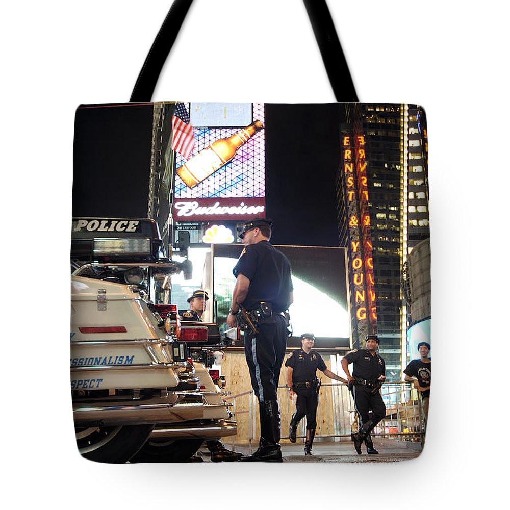 Times Square Tote Bag featuring the photograph Nypd Times Square by Robert Lacy