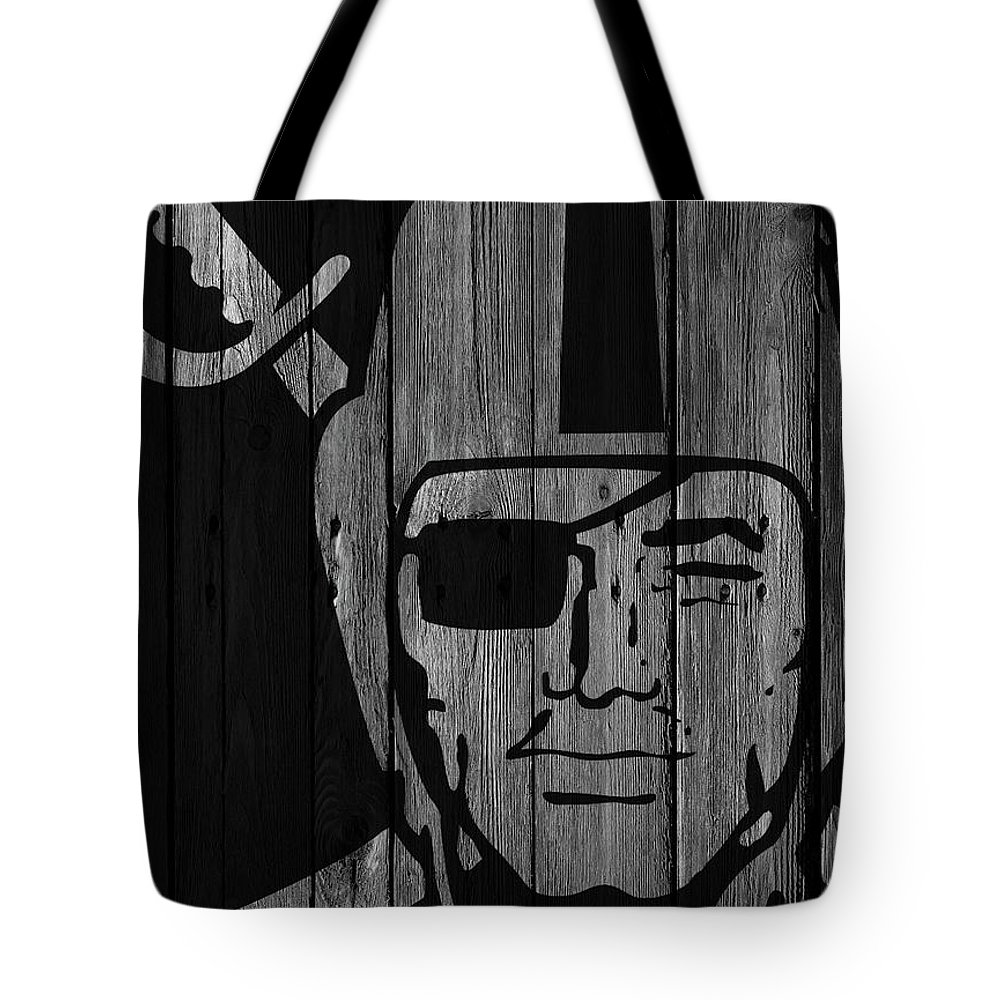 Oakland Raiders Tote Bag featuring the photograph Oakland Raiders Wood Fence by Joe Hamilton