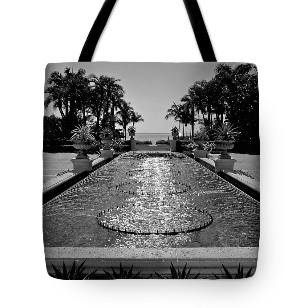 Blue Sky Tote Bag featuring the photograph Ocean Behind Fountain by Dale Chapel