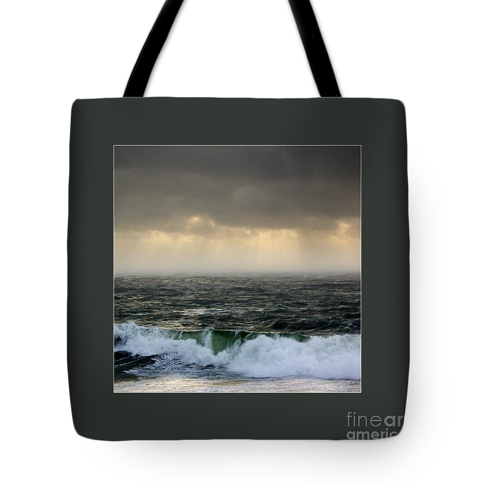 Ochre Sky's And Angry Seas 2 Tote Bag featuring the photograph Ochre Sky's And Angry Seas 2 by Paul Davenport