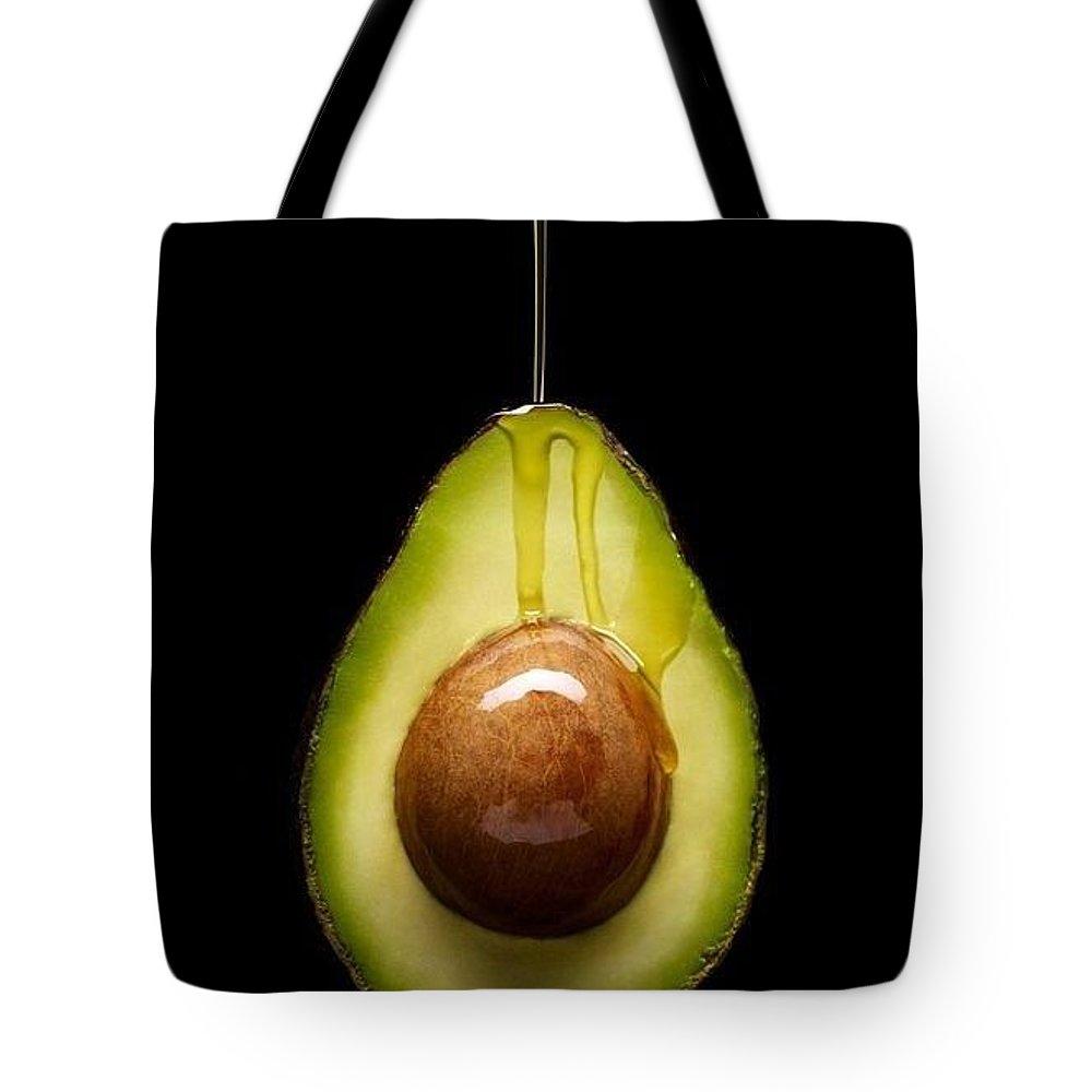 Oil Avocado Tote Bag featuring the digital art Oil Avocado by Aton Maiti