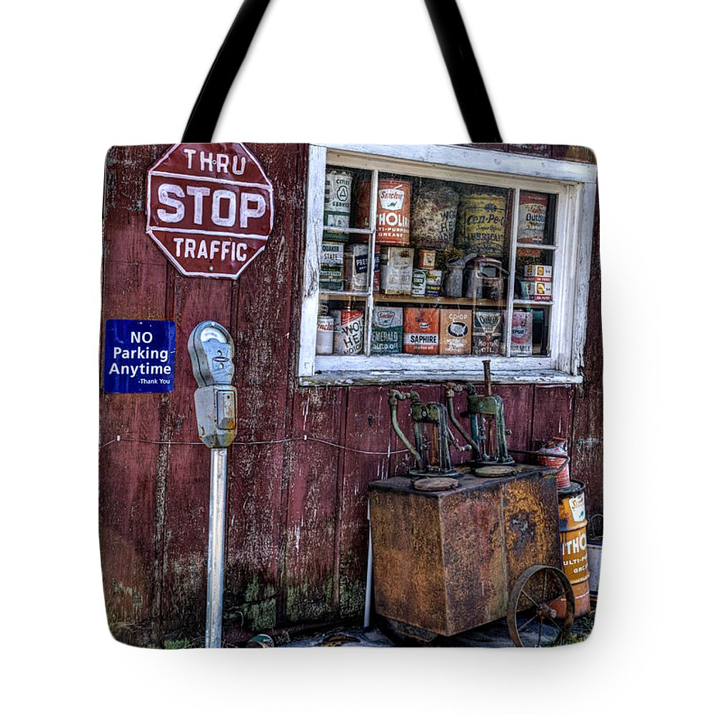 Parking Meter Tote Bag featuring the photograph Oil Cans by Janice Adomeit