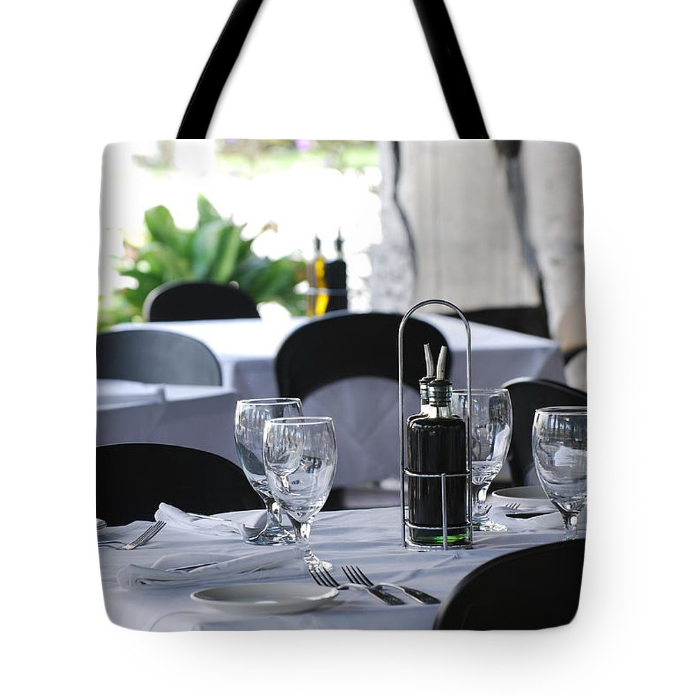 Tables Tote Bag featuring the photograph Oils And Glass At Dinner by Rob Hans