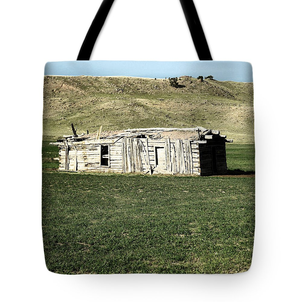 Old Tote Bag featuring the photograph Old Cabin On The Plains by Jeff Swan