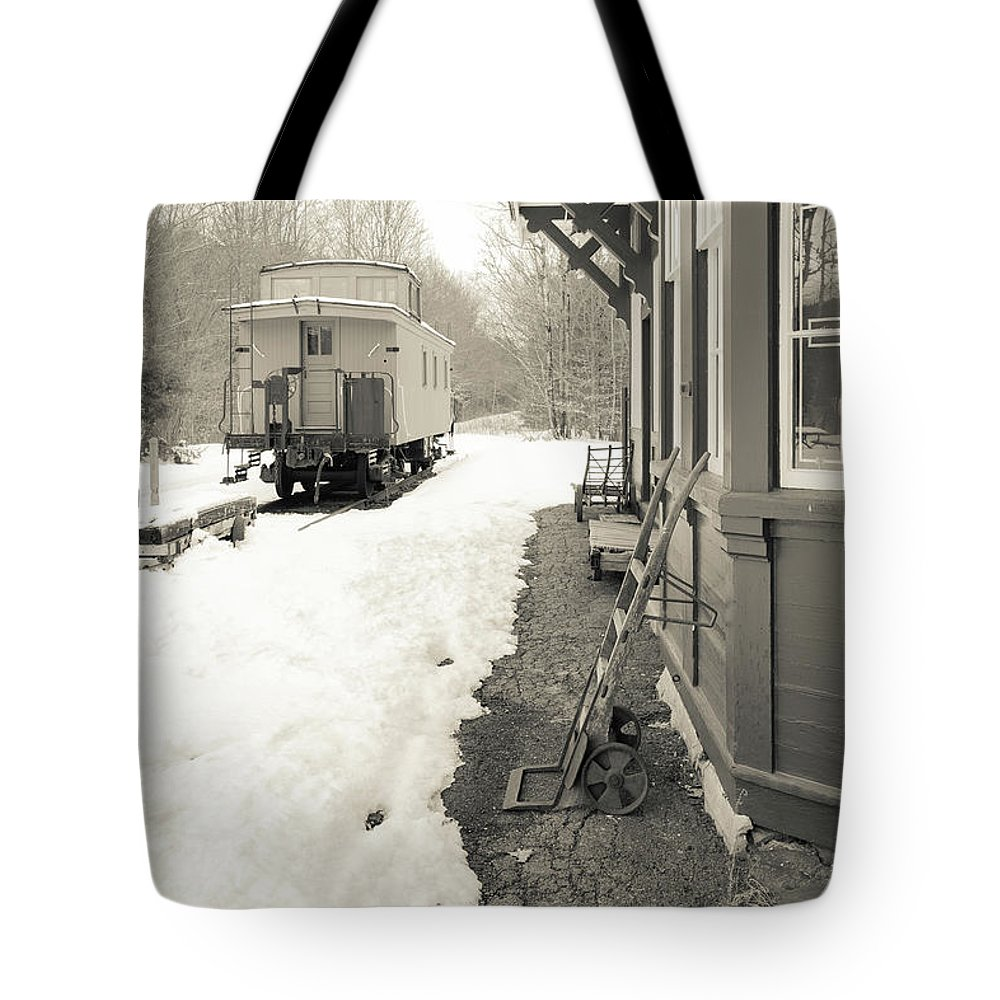 Winter Tote Bag featuring the photograph Old Caboose At Period Train Depot Winter by Edward Fielding