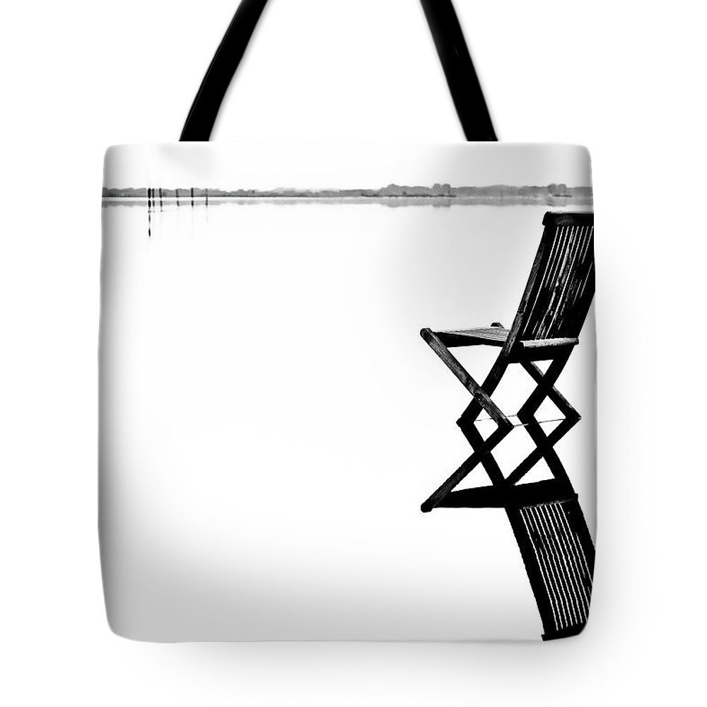 Landscape Tote Bag featuring the photograph Old Chair In Calm Water by Gert Lavsen
