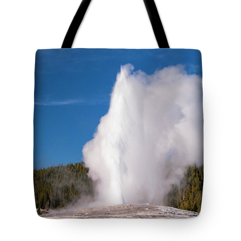Yellowstone National Park Tote Bag featuring the photograph Old Faithful Eruption Two by Bob Phillips