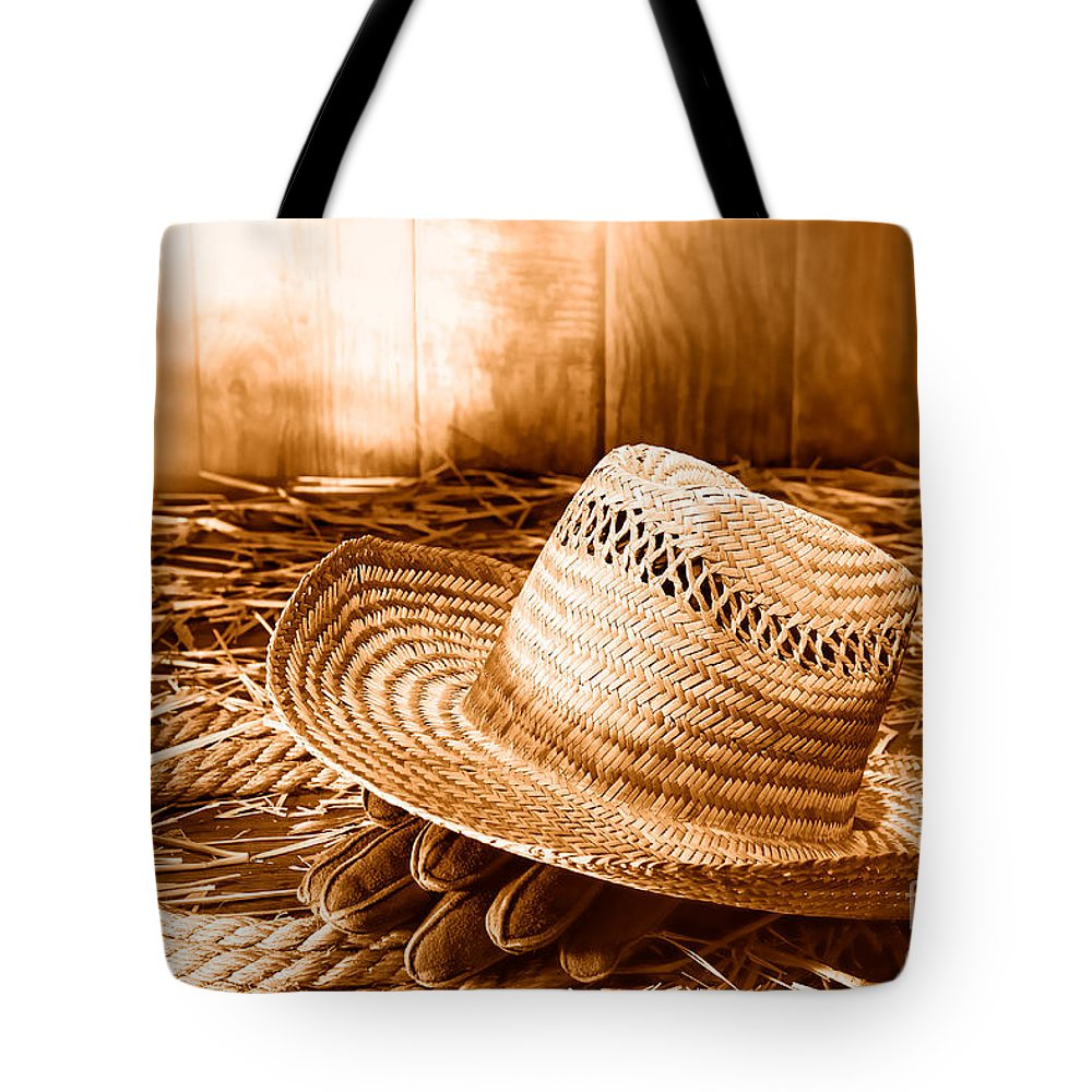 Gloves Tote Bag featuring the photograph Old Farmer Hat In Hay Barn - Sepia by Olivier Le Queinec