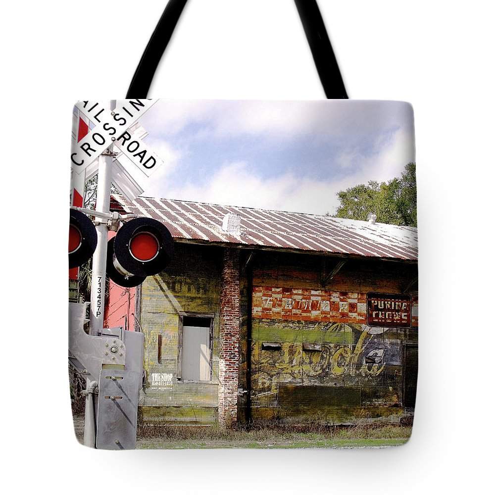 Rr Crossings Tote Bag featuring the photograph Old Freight Depot Perry Fl. Built In 1910 by Marilyn Holkham