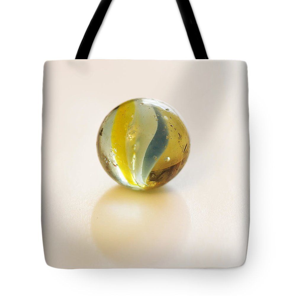 Marble Tote Bag featuring the photograph Old Glass Marble by Tom Conway