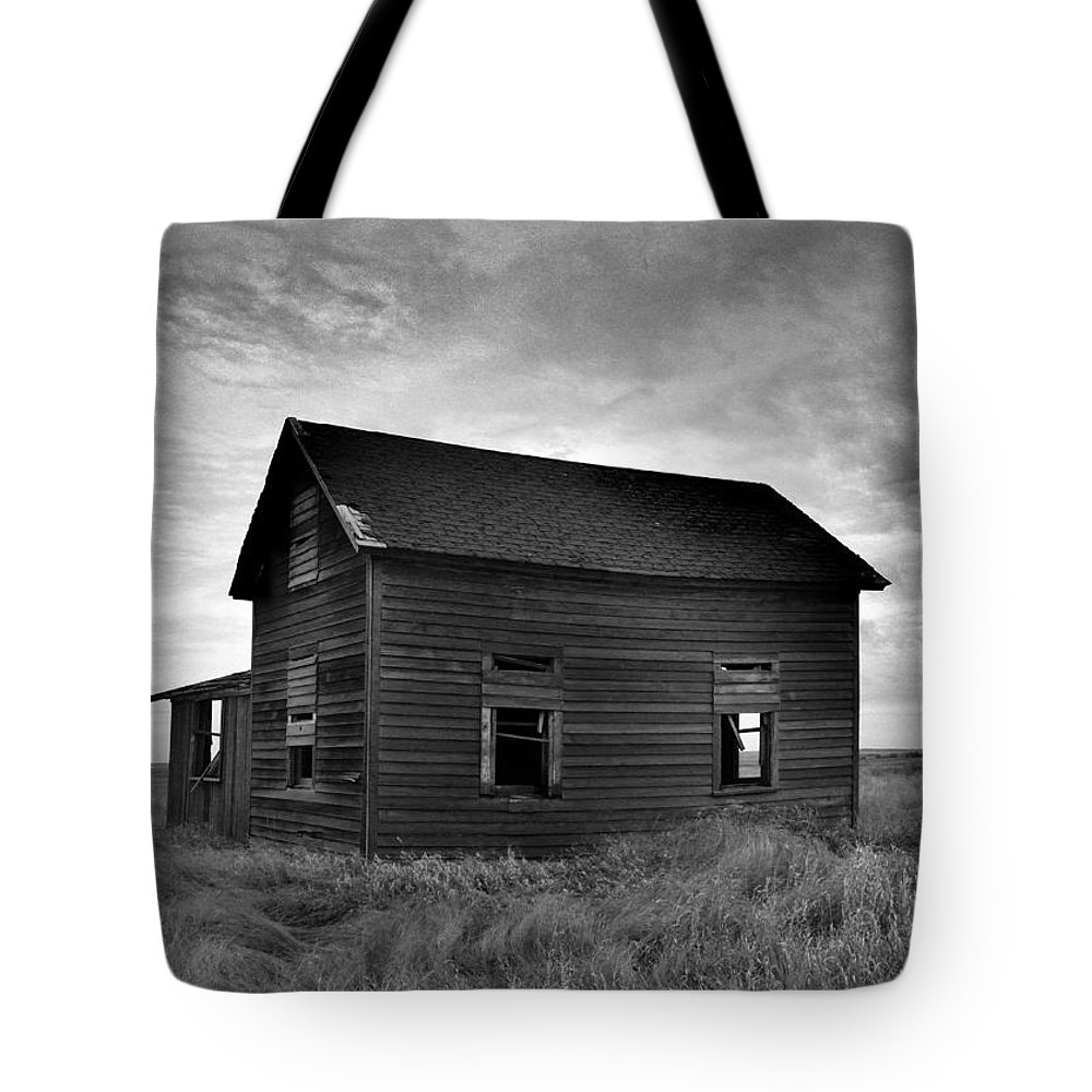 Trees Tote Bag featuring the photograph Old House In A Barren Field by Jeff Swan