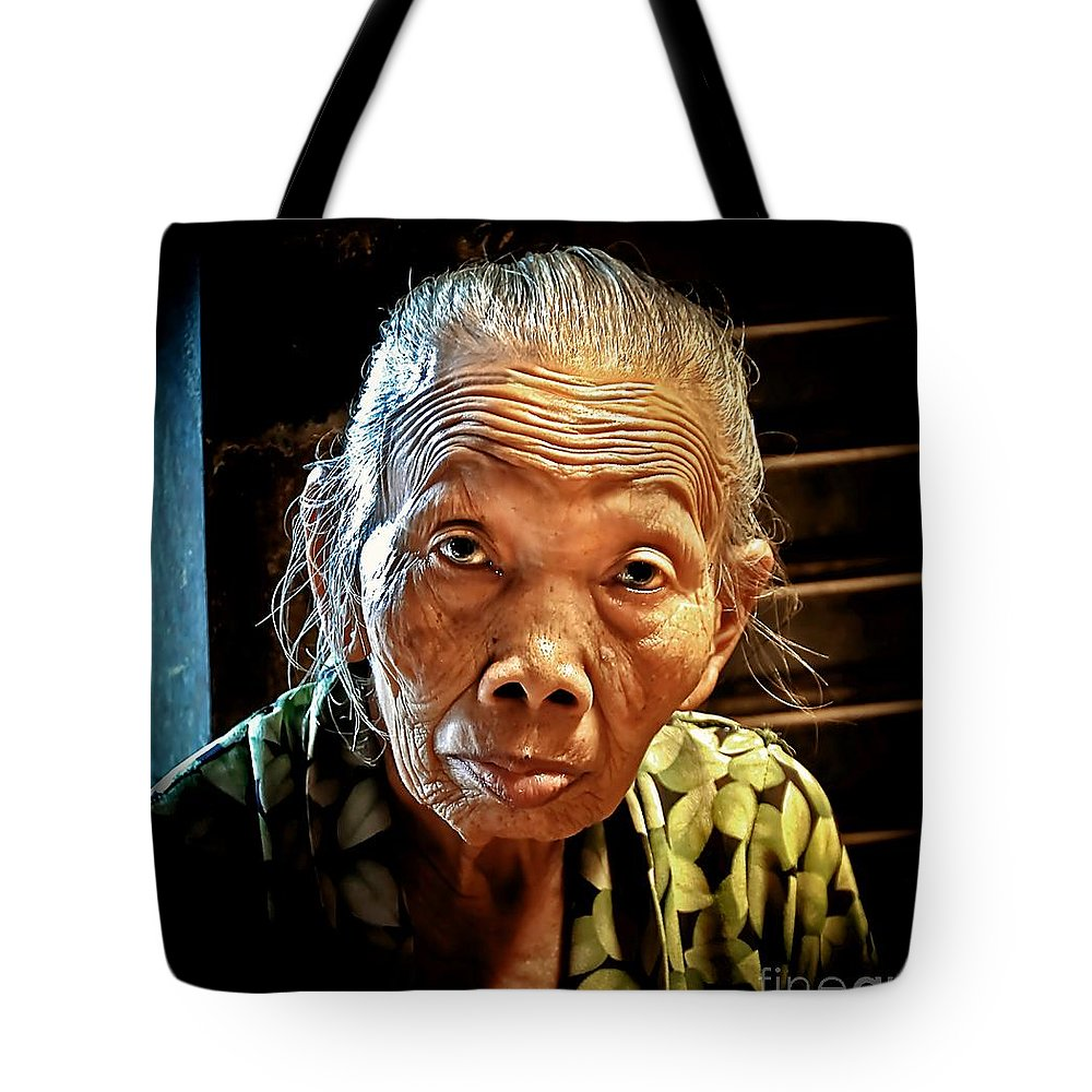 Tote Bag featuring the photograph Old Lady by Charuhas Images