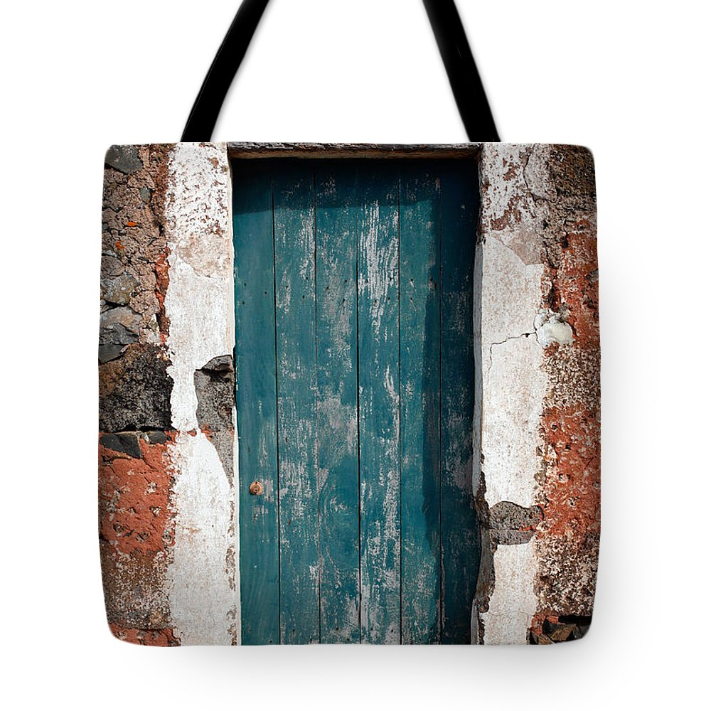Abandoned Tote Bag featuring the photograph Old Painted Door by Gaspar Avila