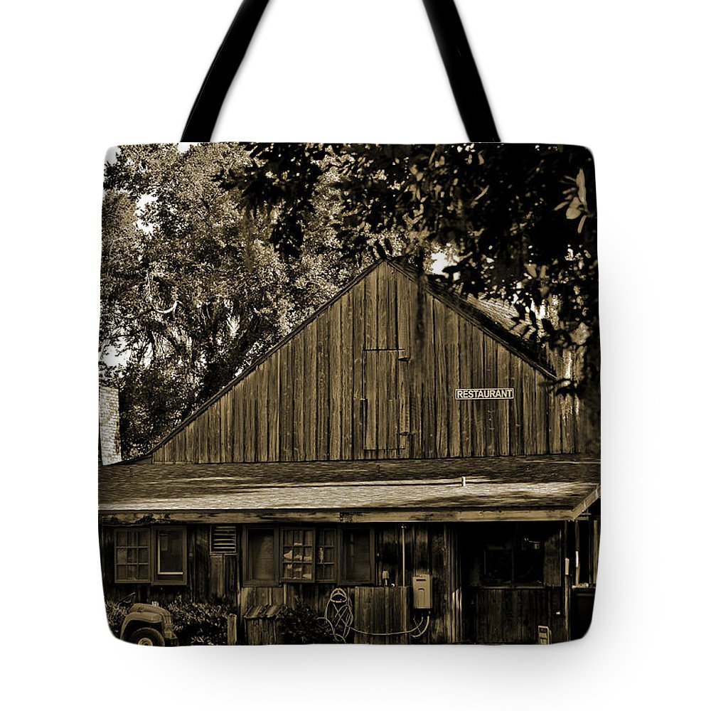 Deleon Springs Tote Bag featuring the photograph Old Spanish Sugar Mill Sepia by DigiArt Diaries by Vicky B Fuller