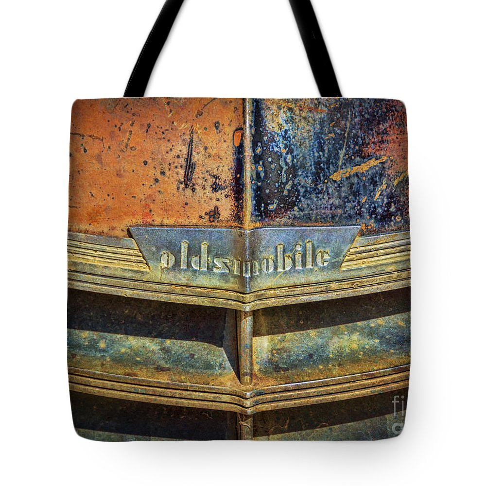 Abandoned Tote Bag featuring the photograph Oldsmobile by Janice Pariza