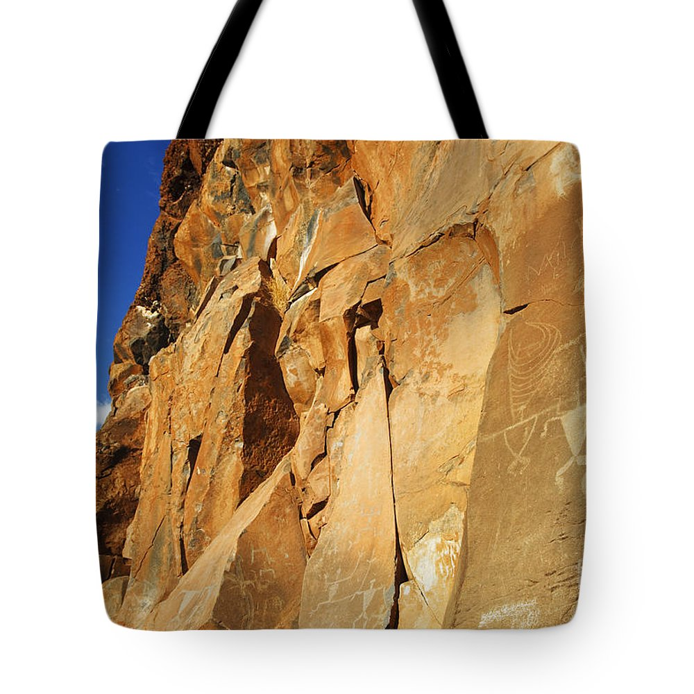 Ancient Tote Bag featuring the photograph Olowalu Petroglyphs by MakenaStockMedia