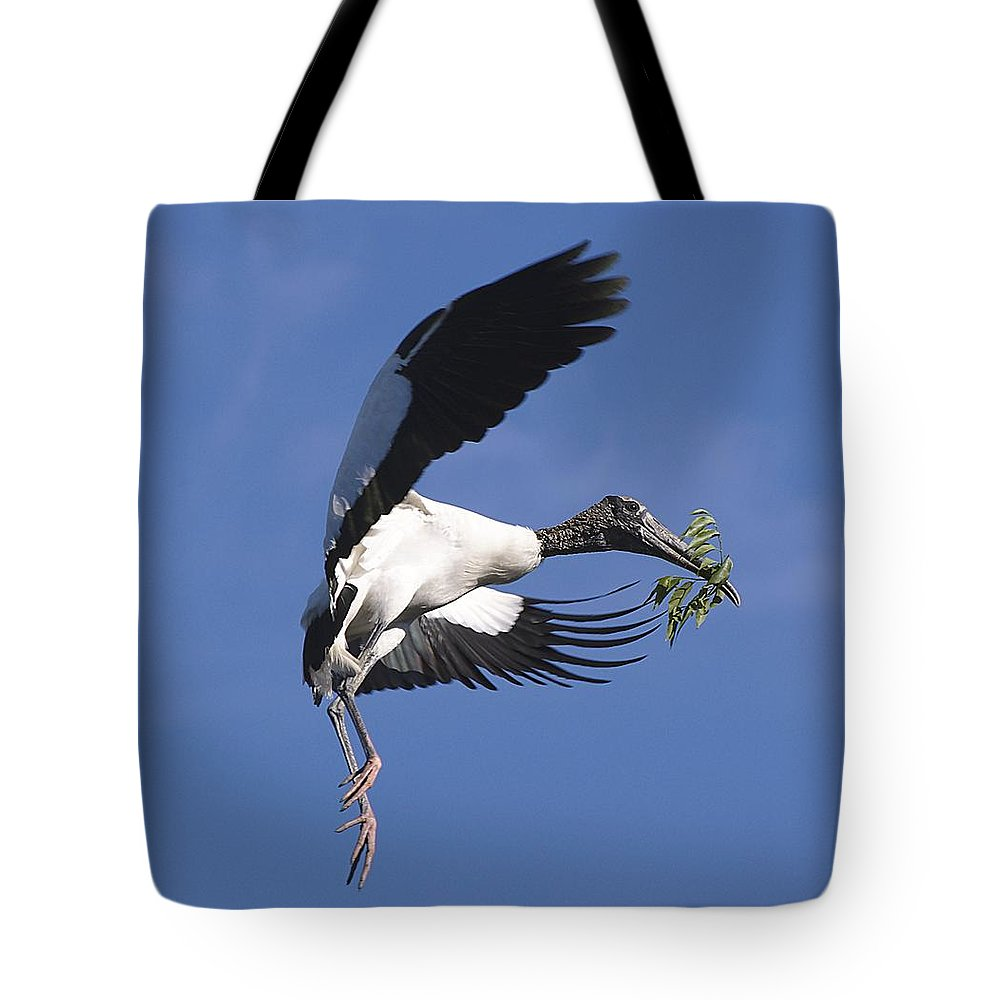 Stork Tote Bag featuring the photograph On A Mission by Kenneth Albin