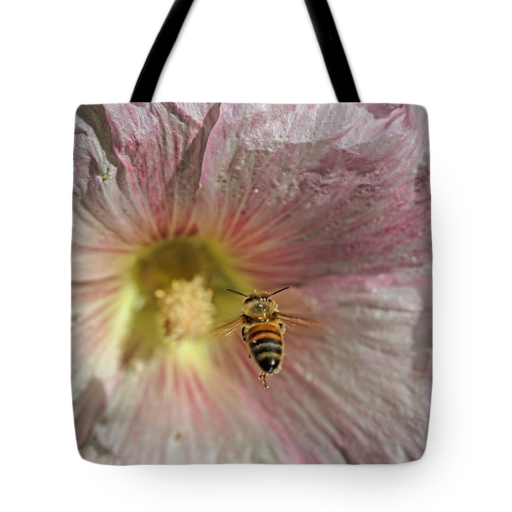 Floral Tote Bag featuring the photograph On Target by Alana Thrower