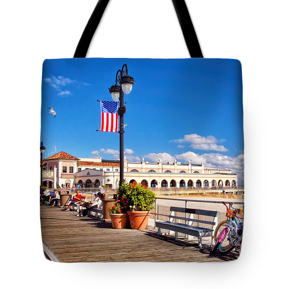 On The Boardwalk Tote Bag featuring the photograph On The Boardwalk by Carolyn Derstine