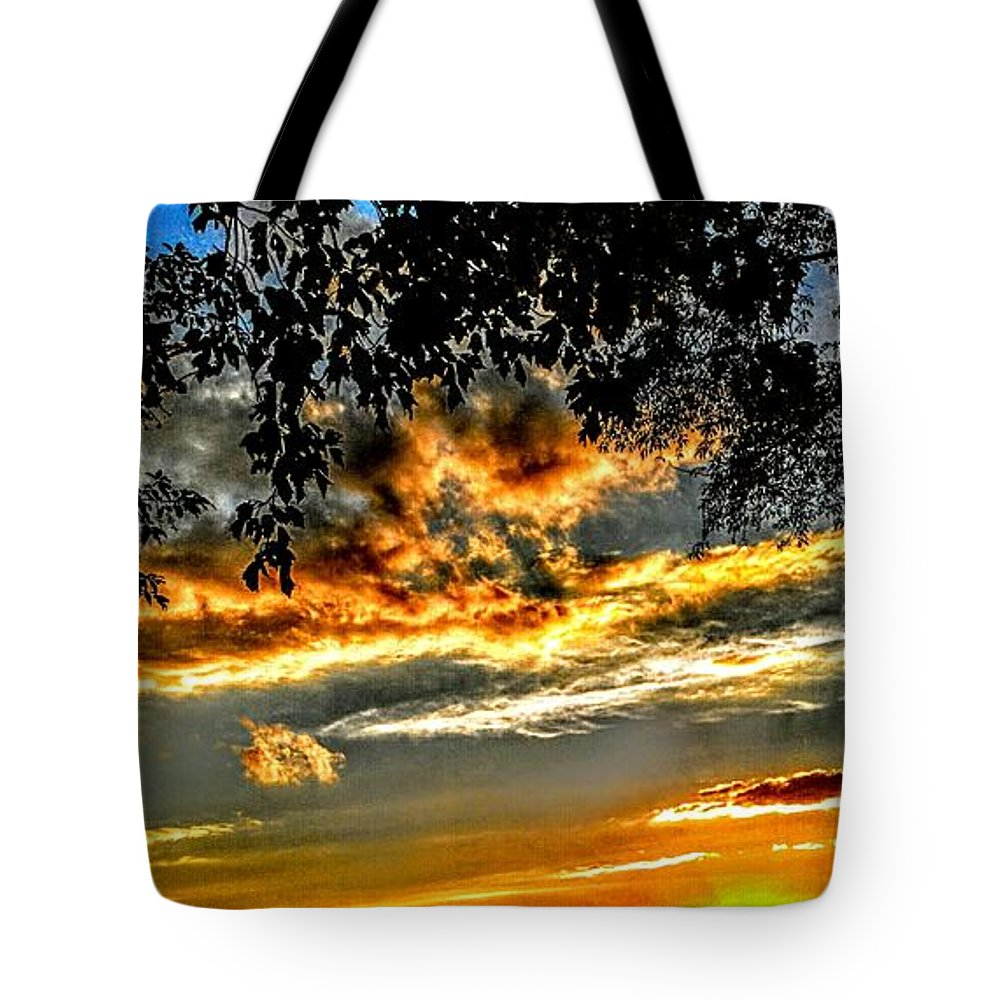 Sunsets Tote Bag featuring the photograph On The Edge Of Night by Paul Kercher