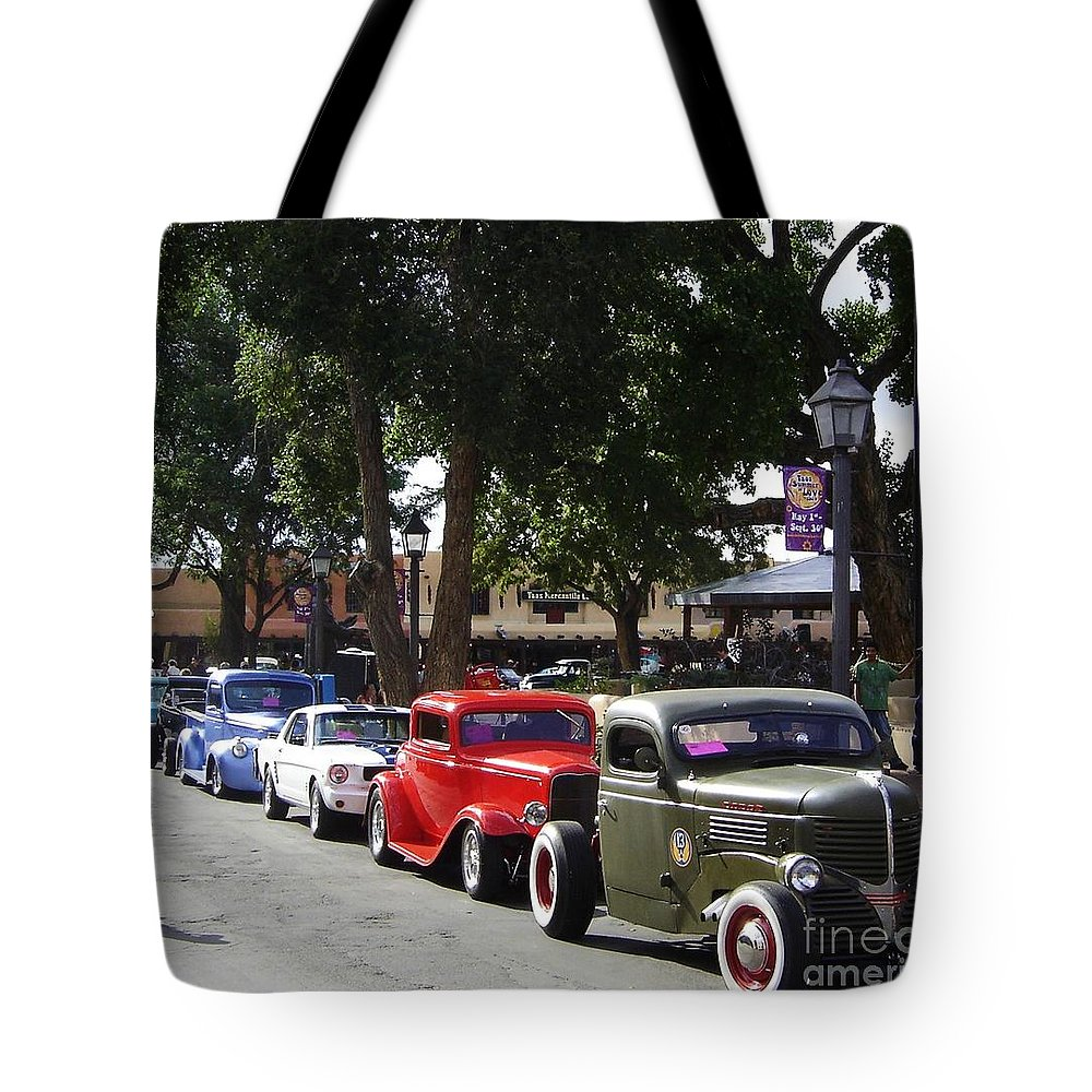Plaza Tote Bag featuring the photograph On The Plaza by Mary Rogers