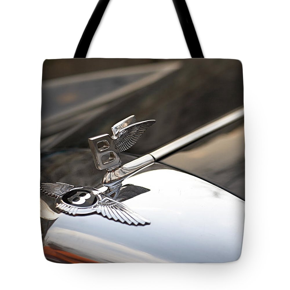 Bentley Tote Bag featuring the photograph On the wings by Antonio Ballesteros