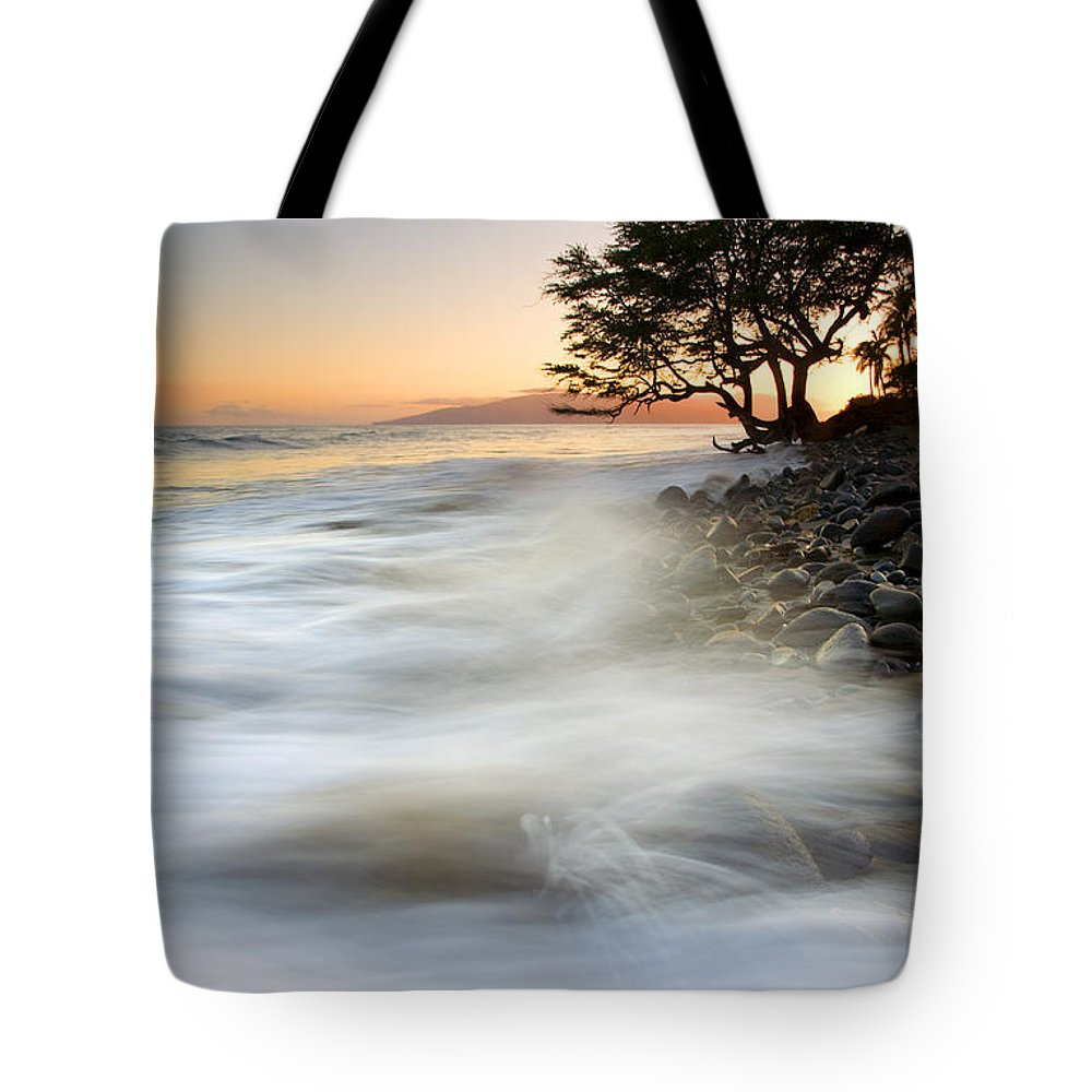Sunset Tote Bag featuring the photograph One Against The Tides by Mike Dawson