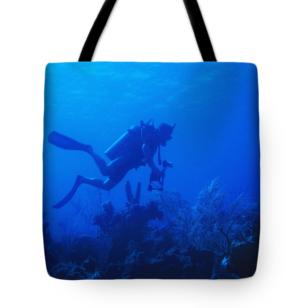 1 Person Tote Bag featuring the photograph One Man Scuba Diving On Coral Reef by James Forte