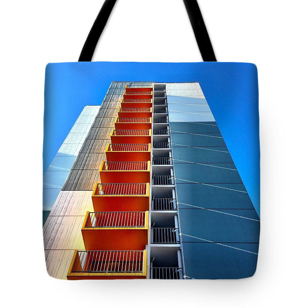 Tote Bag featuring the photograph Orange and Blue Lookup by Julie Gebhardt