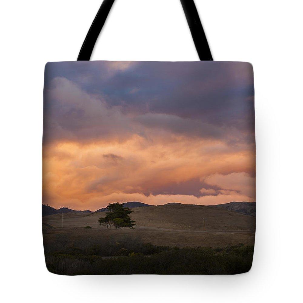 Orange Tote Bag featuring the photograph Orange And Purple Cloud Landscape by Sharon Foelz