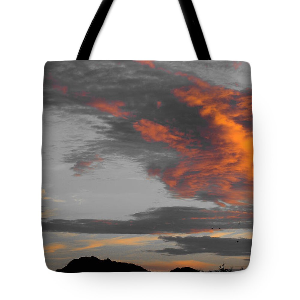Tote Bag featuring the photograph Orange Clouds by Kevin Mcenerney