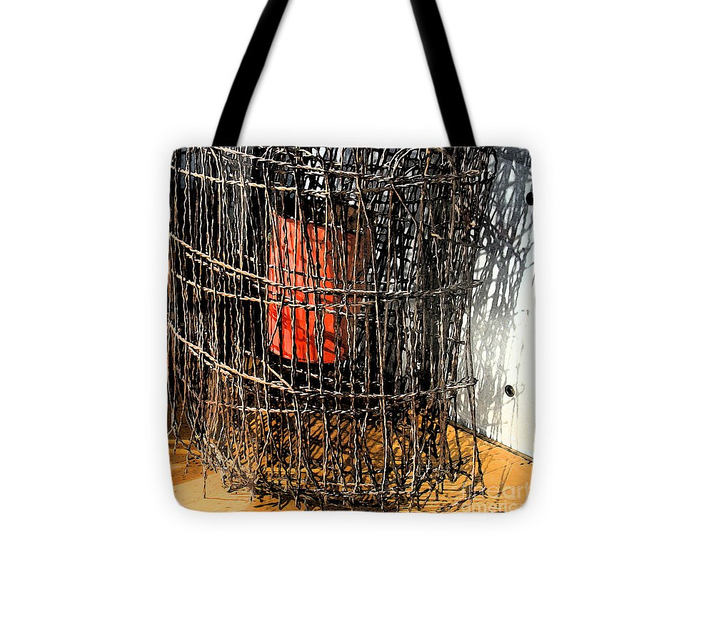 Modern Tote Bag featuring the photograph Orange In Wire by Gary Everson