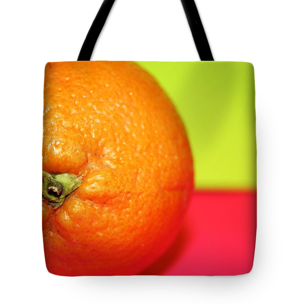 Oranges Tote Bag featuring the photograph Orange by Linda Sannuti