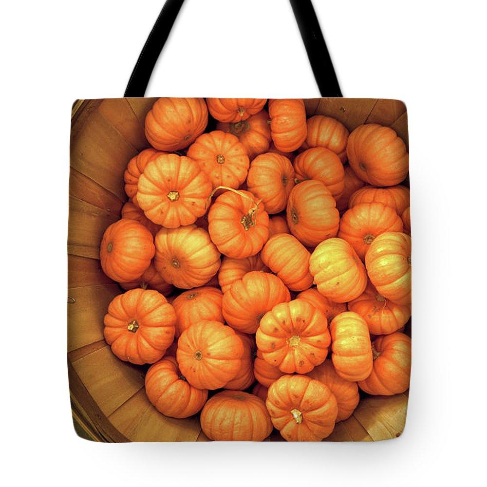 Pumpkins Tote Bag featuring the photograph Orange Pumpkins Autumn Background. by Konstantin Sutyagin