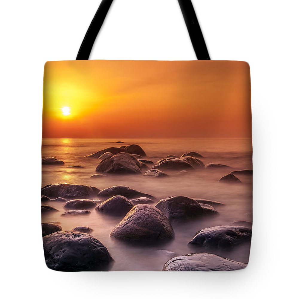 Background Tote Bag featuring the photograph Orange Sunset Long Exposure Over Sea And Rocks by Sandra Rugina