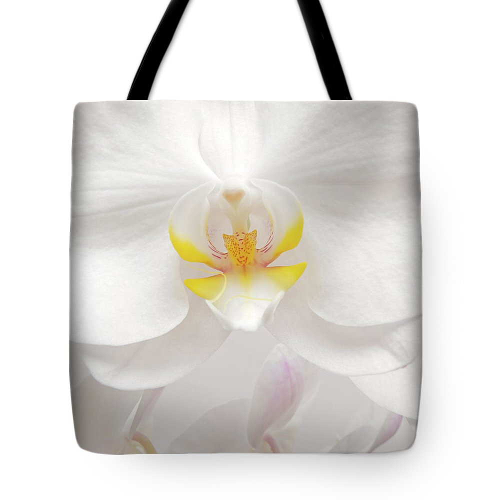 White Tote Bag featuring the photograph Orchid by Wim Lanclus