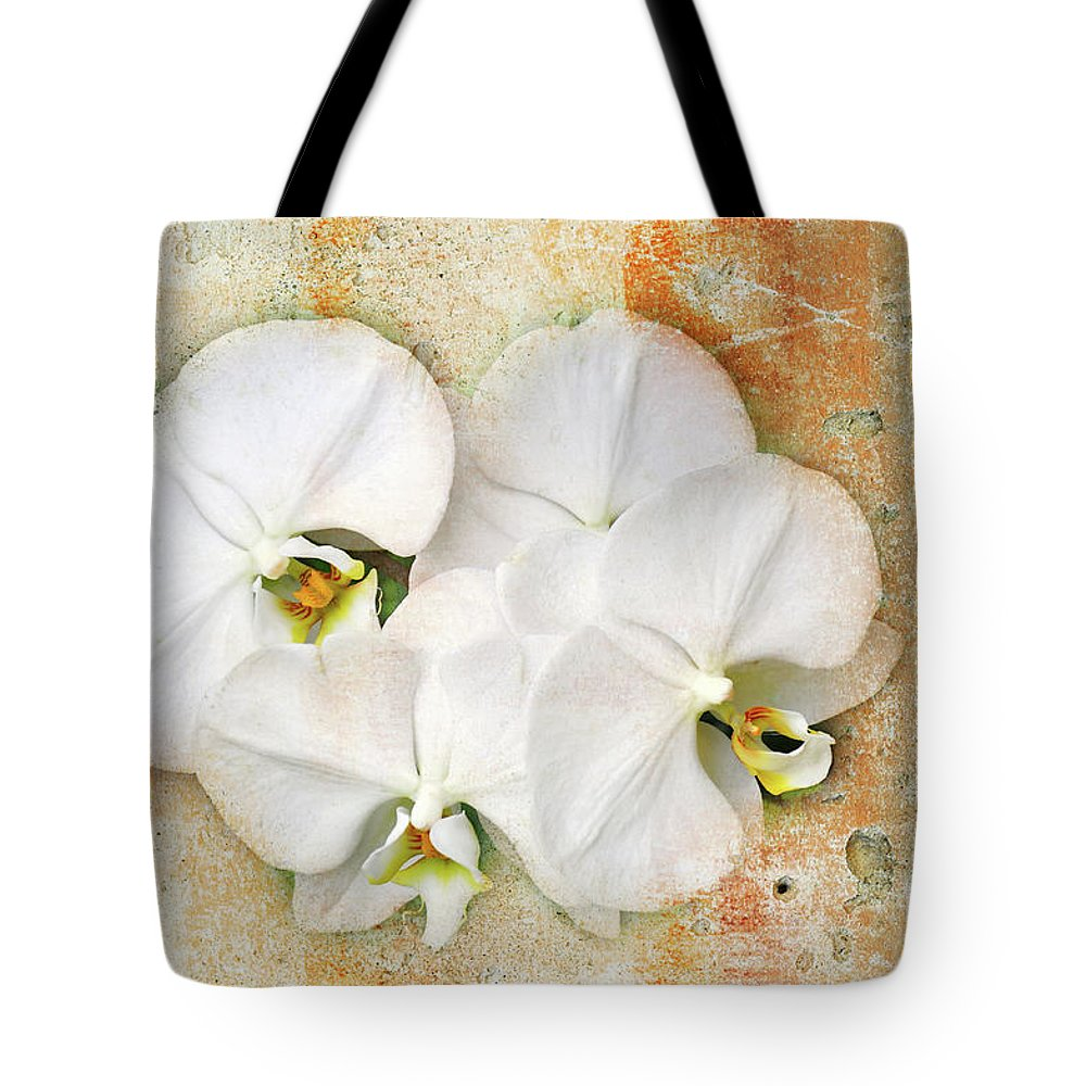 Orchids Tote Bag featuring the photograph Orchids Upon The Rough by Andee Design