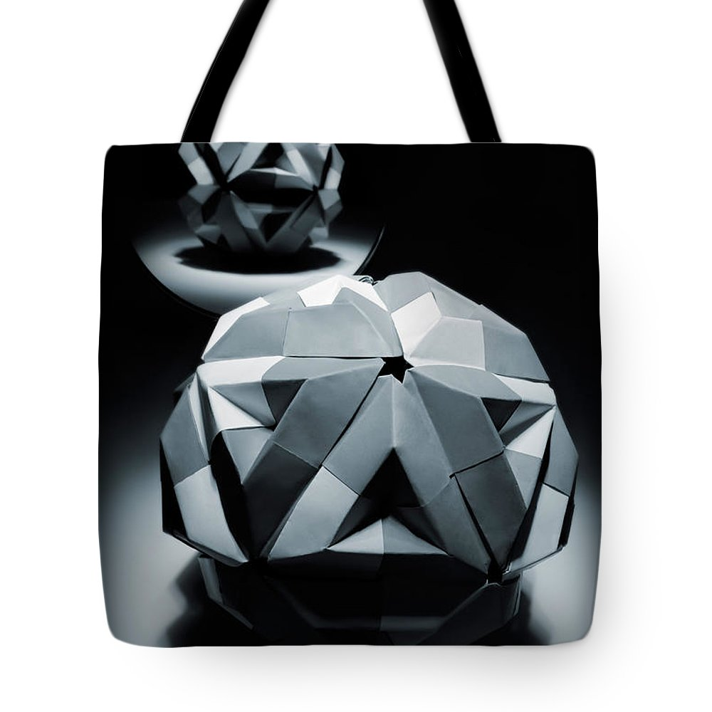 Origami Tote Bag featuring the photograph Origami Paper Sphere by Oleksiy Maksymenko