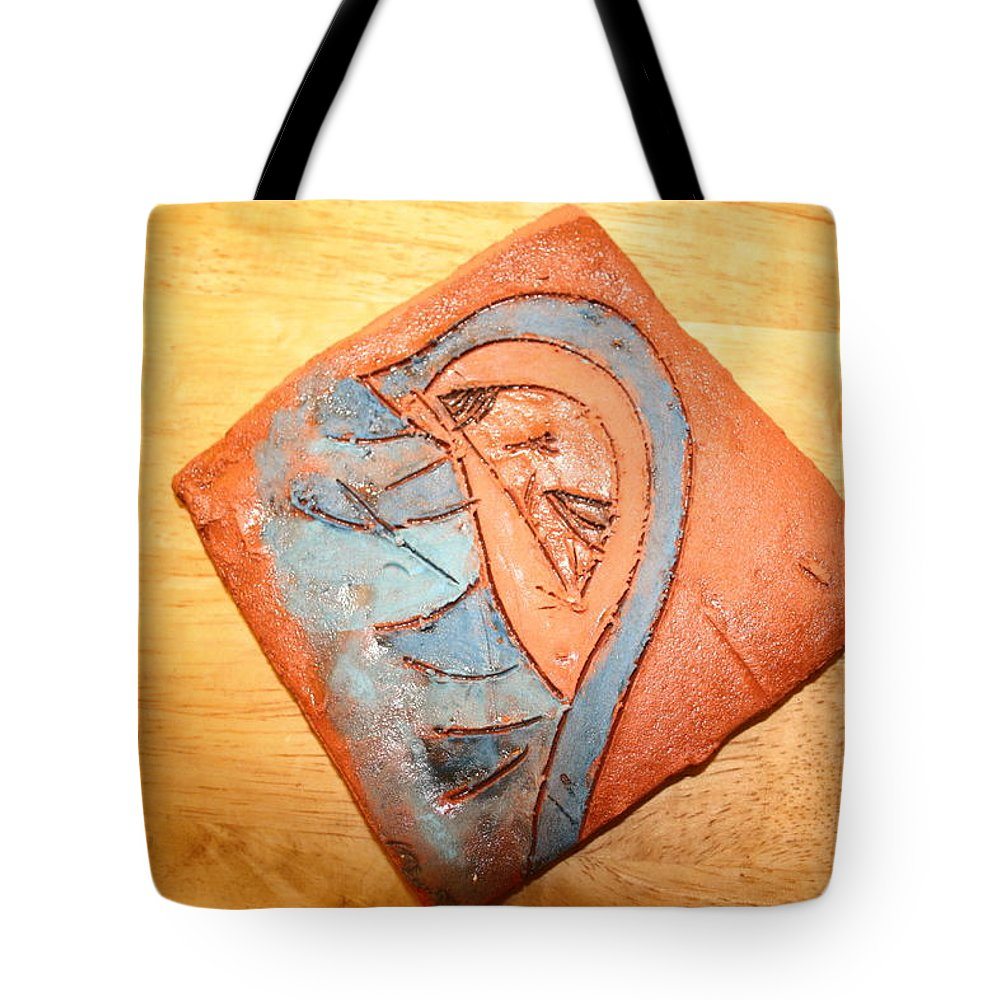 Jesus Tote Bag featuring the ceramic art Ozukusee - Tile by Gloria Ssali