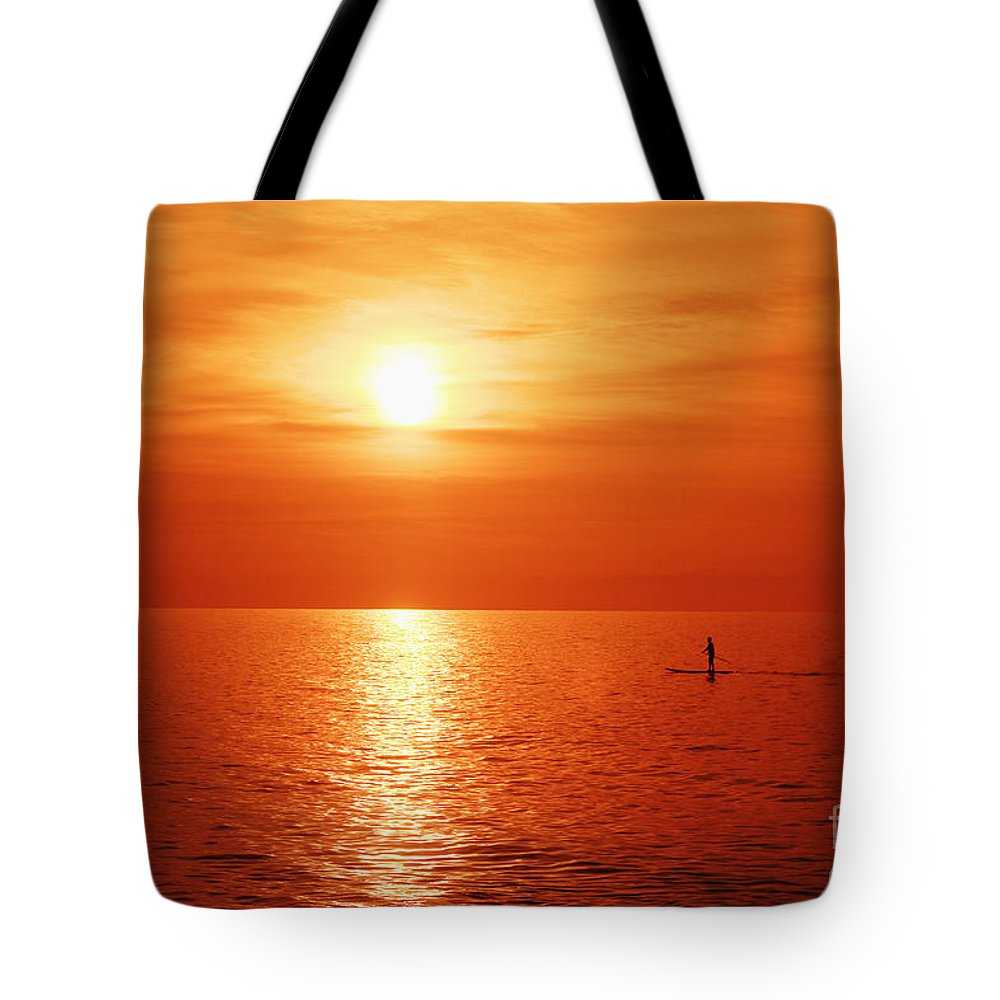 Afternoon Tote Bag featuring the photograph Paddle Surfer Sunset by Vince Cavataio - Printscapes