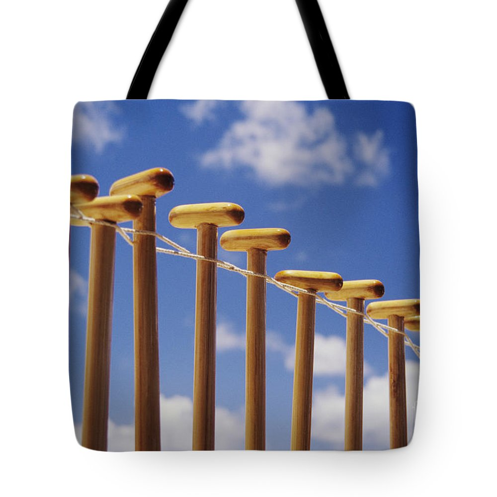 Air Tote Bag featuring the photograph Paddles Hanging In A Row by Joss - Printscapes