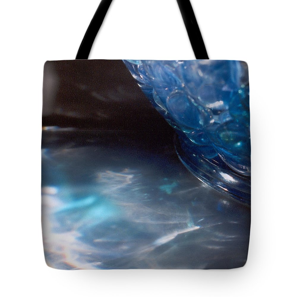 Abstract Tote Bag featuring the photograph Panel One From Swirl by Steve Karol